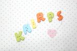 """Buchstabenhits für Kids 18mm - 2-Loch Knopf  """"K """" Beispielbild  """"Knirps """""""